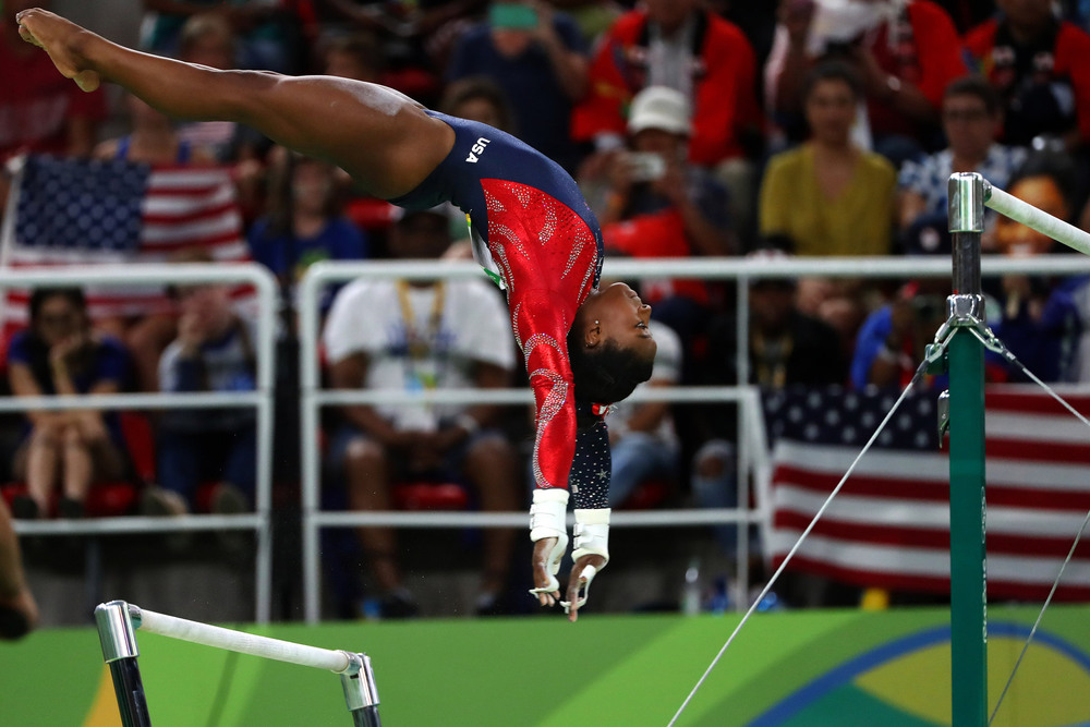 29 Август. The American gymnast Simone Biles performed on the uneven bars at the Olympics gymnastics arena. She won four gold medals at the Games.Chang W. Lee