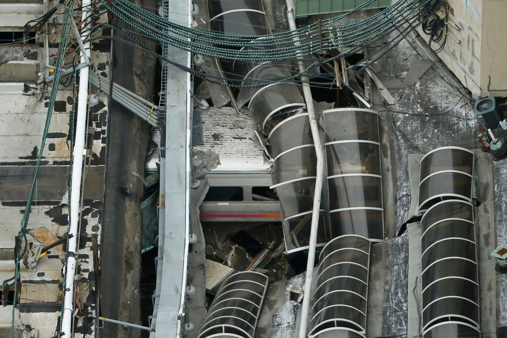36 Сентябрь. A derailed New Jersey Transit train sat under a collapsed roof after crashing into a train station. The accident killed a young mother and injured more than 100 people.Carlo Allegri/Reuters