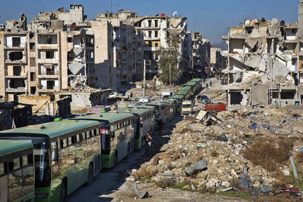 48 Декабрь. Buses carried residents evacuating rebel-held areas.Karam Al-Masri/Agence France-Presse — Getty Images