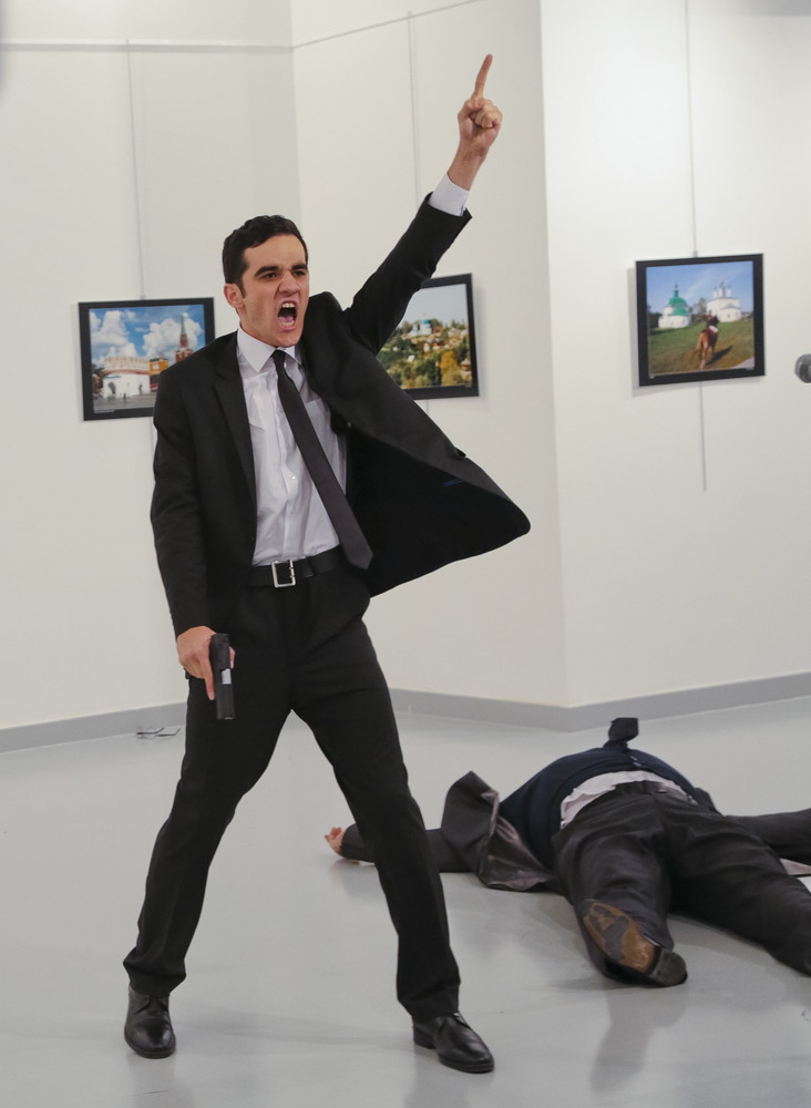 49 Декабрь. A gunman gestured after assassinating Andrey G. Karlov, the Russian ambassador to Turkey, at an art exhibit.Burhan Ozbilici/Associated Press