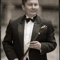Актор театру і кіно Олег Артамонов