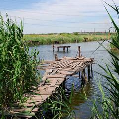 Рыбацкие мостки в промышленном районе...