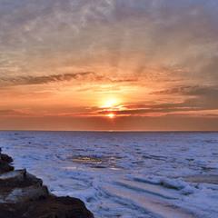 Winter sunrise at sea
