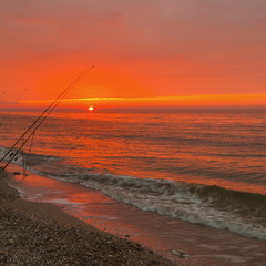 The fisherman catches the rising Sun