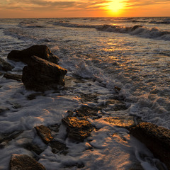The churning sea water, illuminated by the morning sun