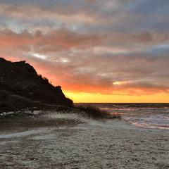Foamy sea at sunrise