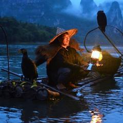 рыбак с бакланами