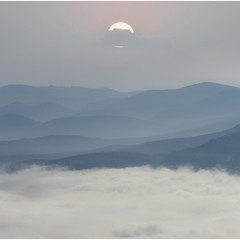 The sea of clouds, mountains and the sun