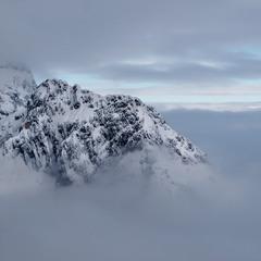 Поднявшись к облакам