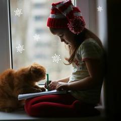девочка с котом пишут письмо деду морозу