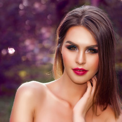 Attractive young woman with beuty makeup outdoors