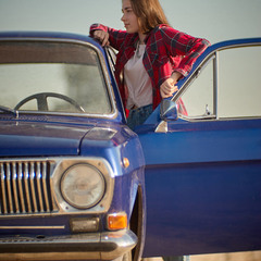 Lovely girl and old car