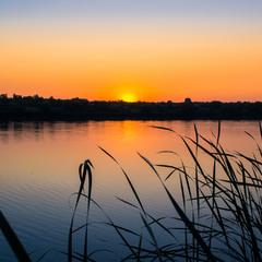 Захід сонця над рікою Інгулець