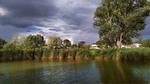 Над річкою село біліє